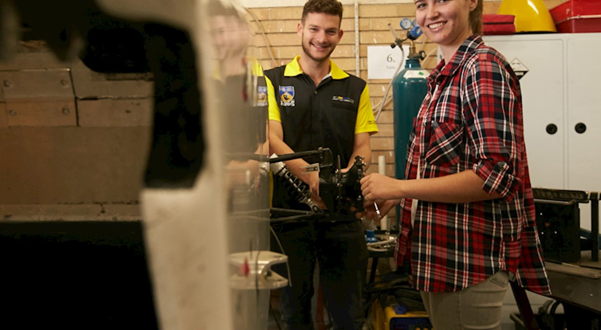Motorsport students in a workshop