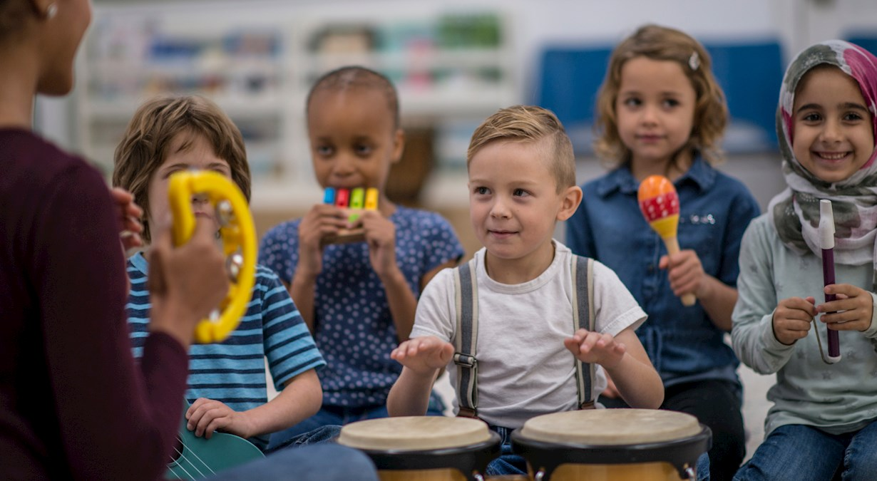Early learner children playing musical instruments