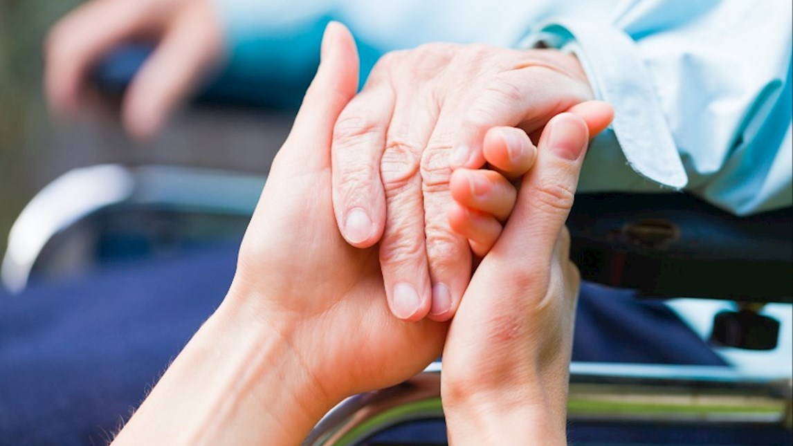 Elderly person receiving care.