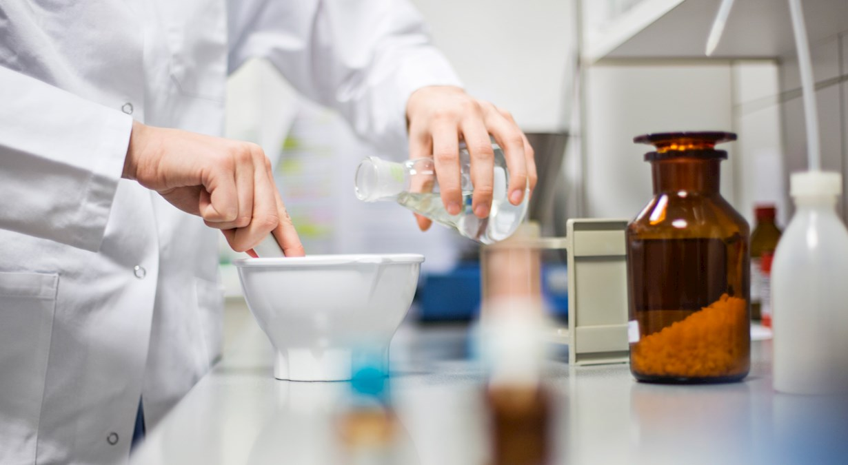 Pharmacist formulating and researching drug delivery