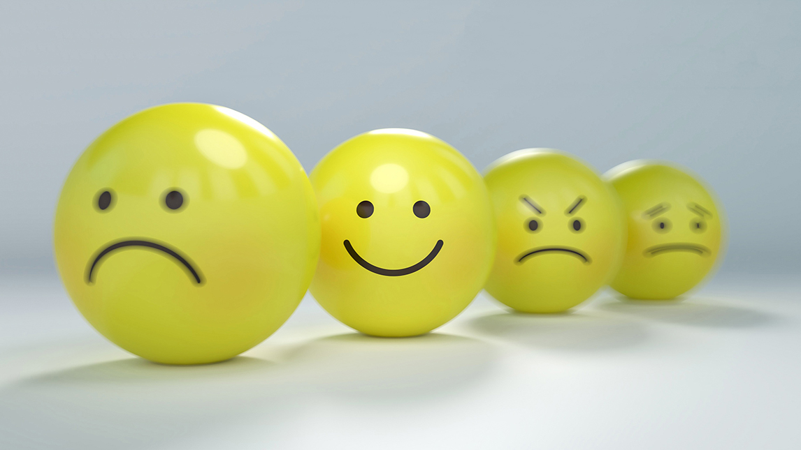 yellow balls with various emotions