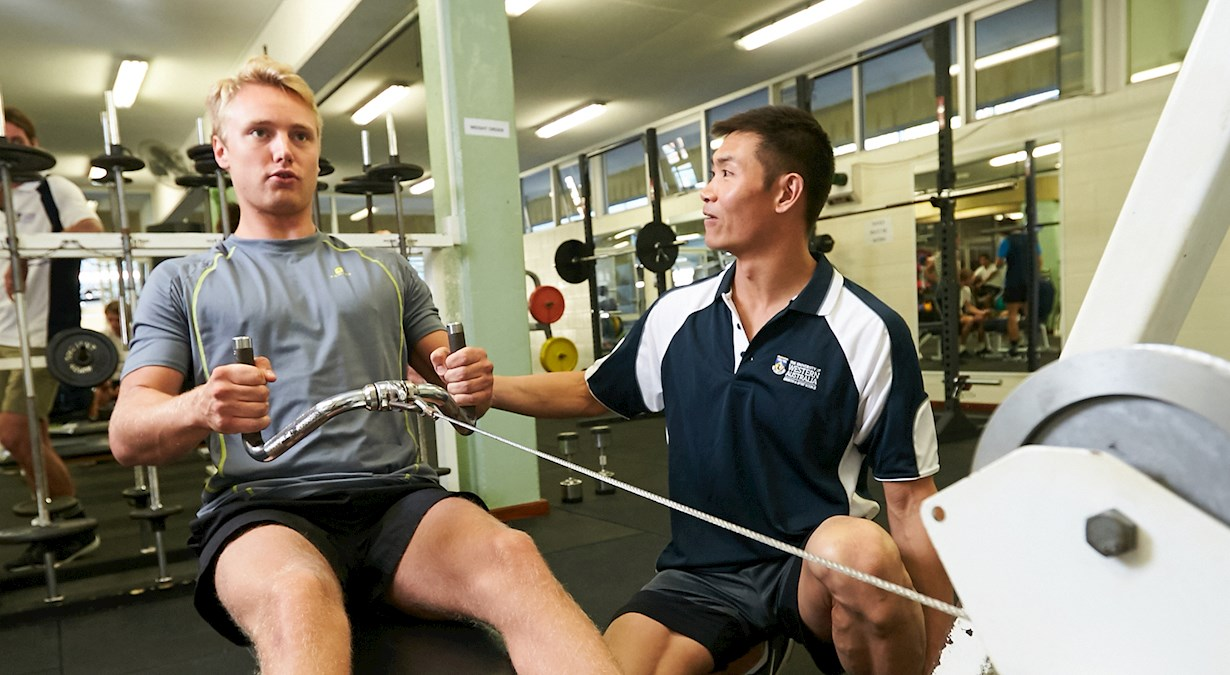 student on rowing machine