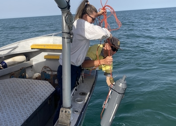 Paula Cartwright taking water samples in Exmouth Gulf