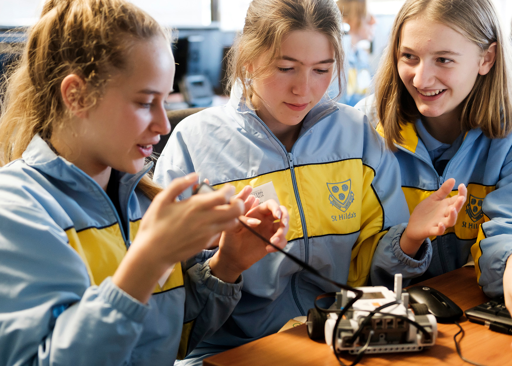 High school girls working on a robotics project