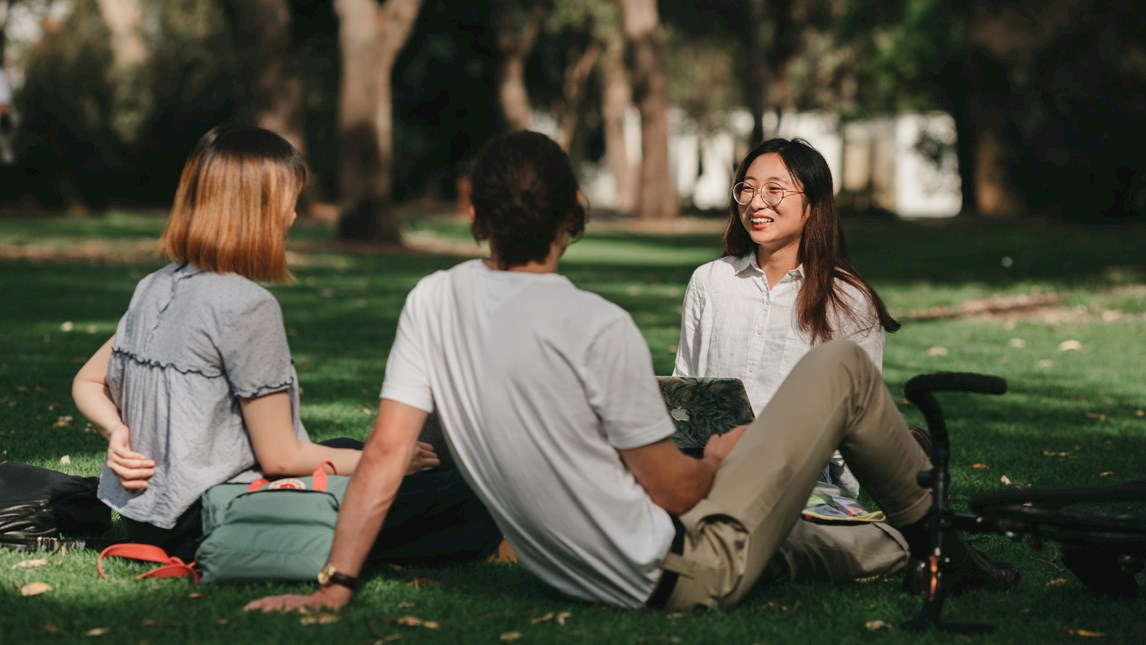 Students sitting and talking on University grounds