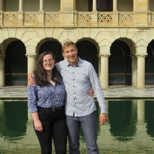 Rachel Bannerman and Paris Buti standing in front of Winthrop Hall and Reflection Pond