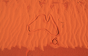 Outline of Australia drawn in red dirt
