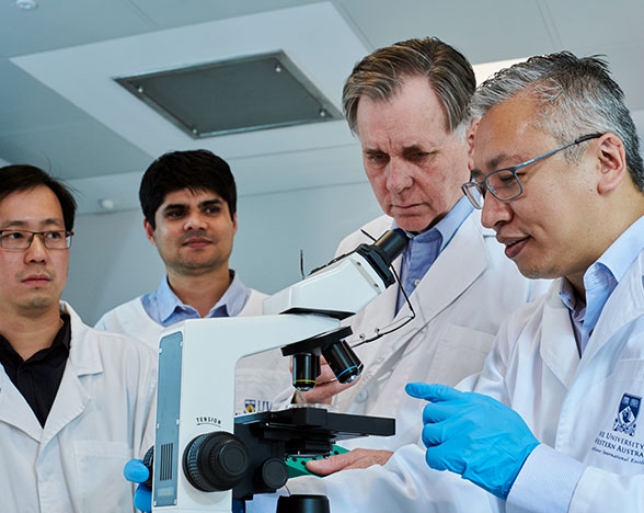 Professor Barry Marshall, Dr Alfred Tay and their team working on Helicobacter Pylory