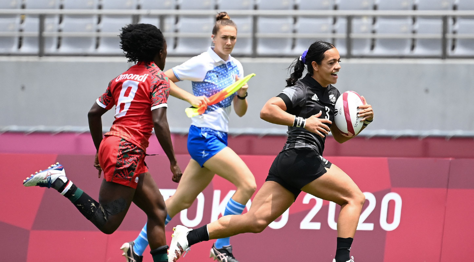 New Zealand's Stacey Fluhler (R) runs in for a try as she is chased by Kenya's Sinaida Omondi during the women's pool A rugby sevens match between New Zealand and Kenya during the Tokyo 2020 Olympic Games at the Tokyo Stadium in Tokyo on July 29, 2021. (Photo by GREG BAKER / AFP) (Photo by GREG BAKER/AFP via Getty Images)