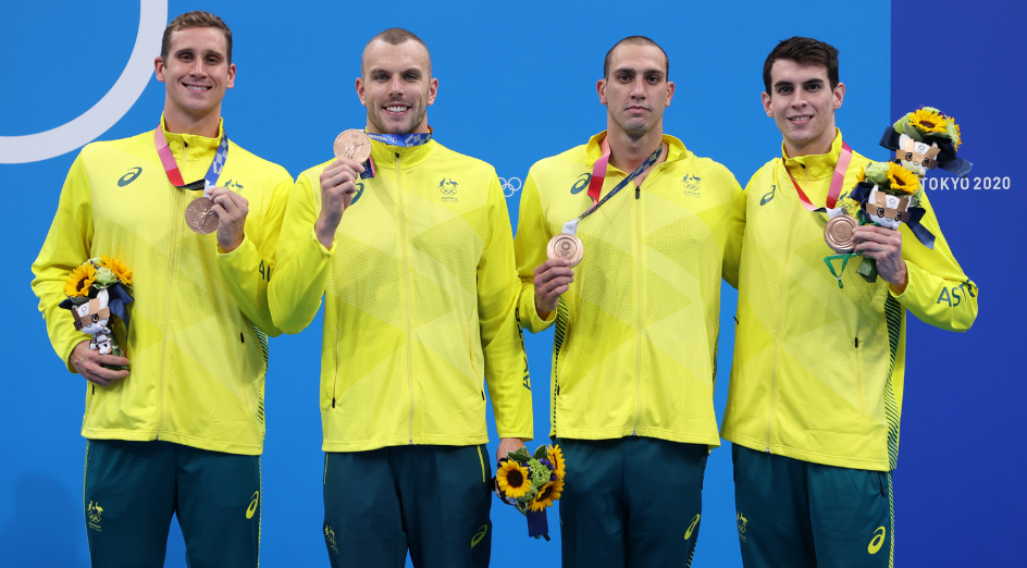 TOKYO, JAPAN - JULY 28: Alexander Graham, Kyle Chalmers, Zac Incerti and Thomas Neill of Team Australia celebrate during the medal ceremony for the Men's 4 x 200m Freestyle Relay Final on day five of the Tokyo 2020 Olympic Games at Tokyo Aquatics Centre on July 28, 2021 in Tokyo, Japan. (Photo by Al Bello/Getty Images)