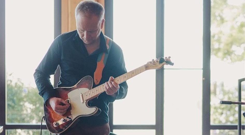 James Ledger playing guitar