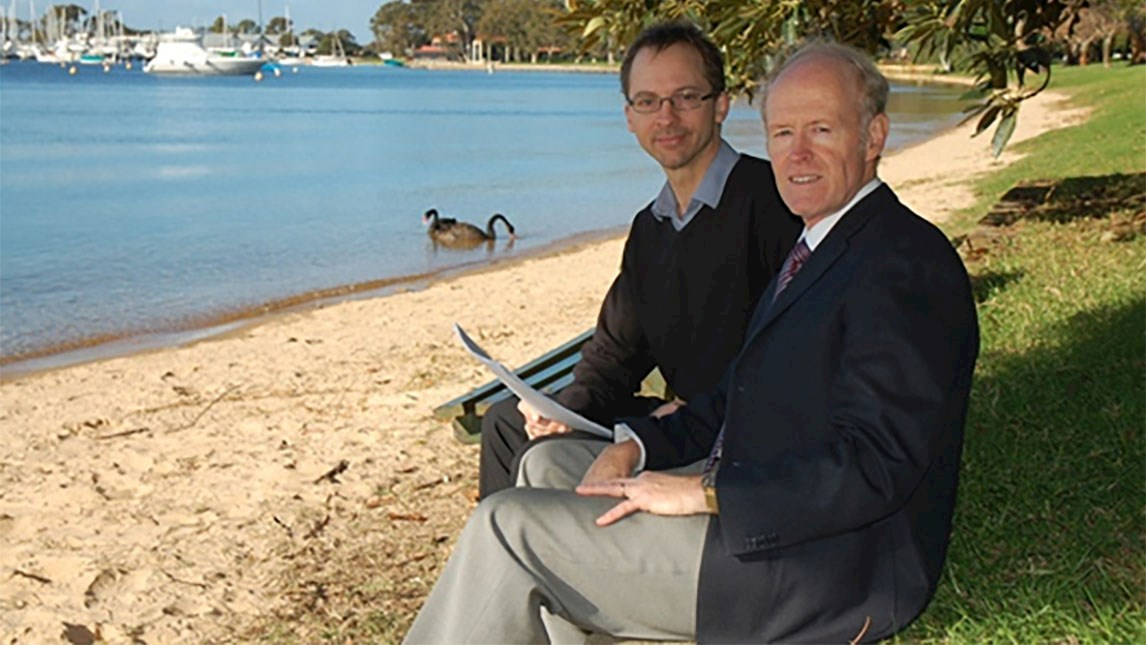 Professor Alex Gardner seated on foreshore with Michael Bennett