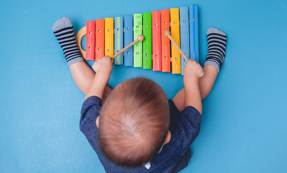 Toddler playing musical instruments