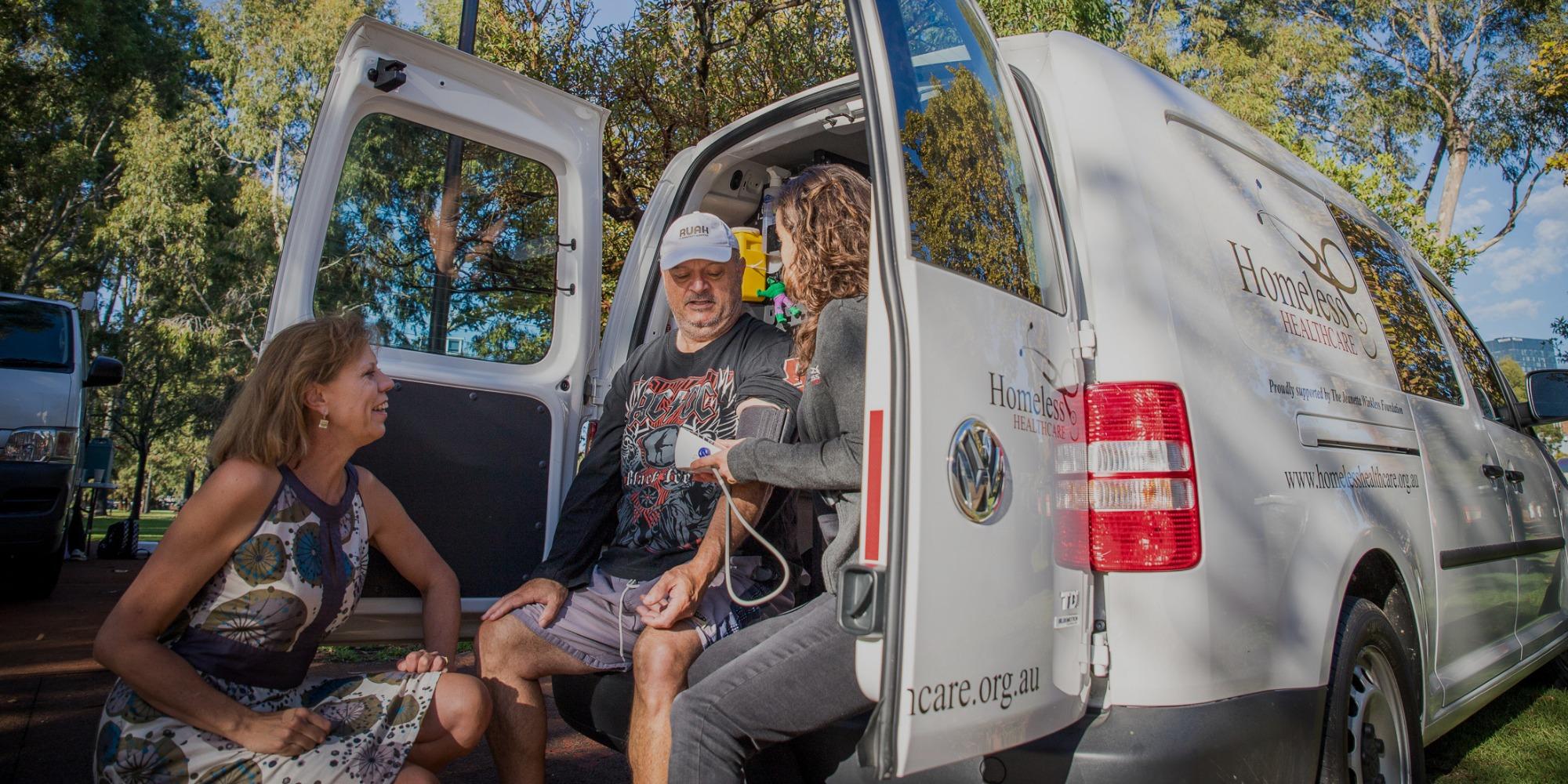 Professor Lisa Wood with the Homelessness van