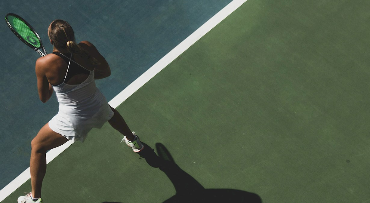 Elite tennis player on court preparing to return a serve