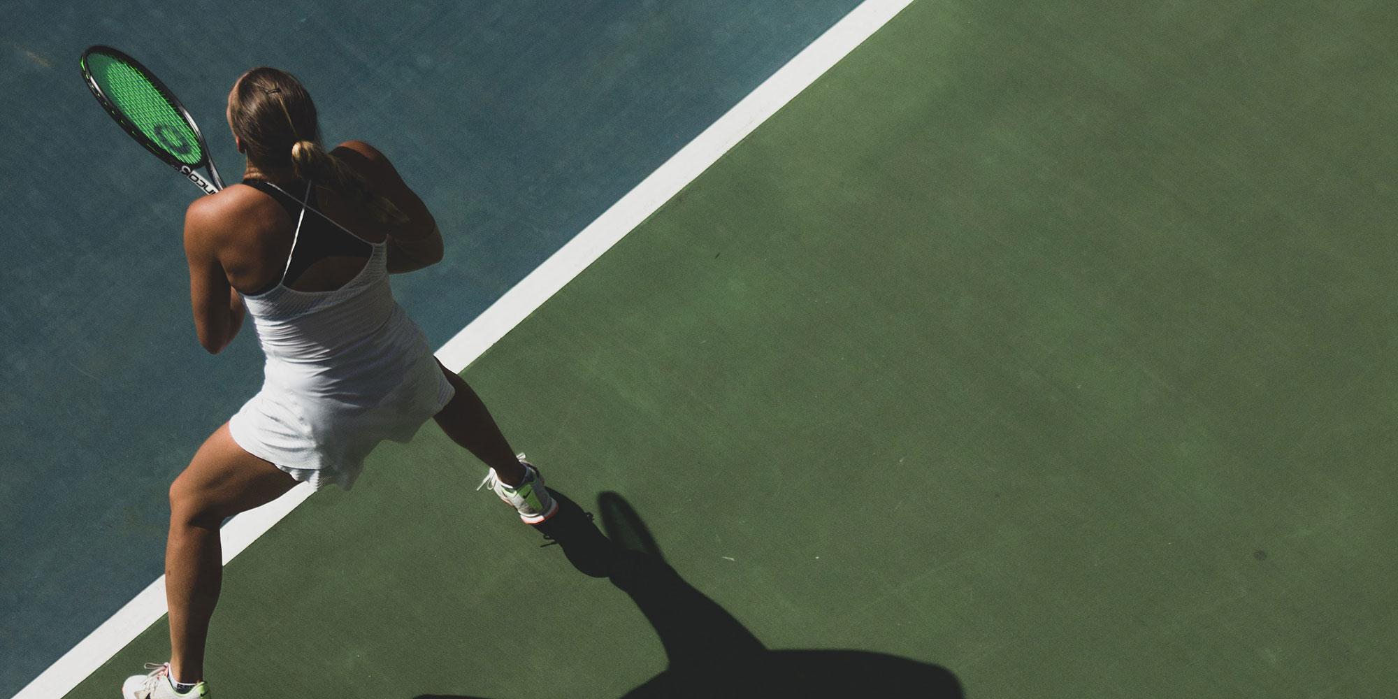 Elite tennis player on court preparing to return a serve