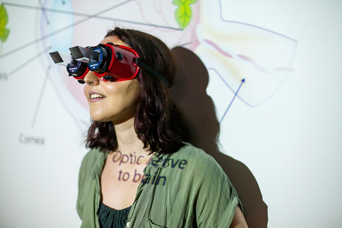 Woman wearing vision measuring device