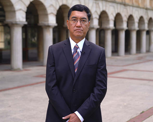 Amit Chakma standing at the back of Winthrop Hall.