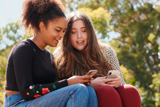 Two female students using mobile phones