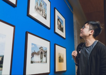 Student looking at prints on a wall