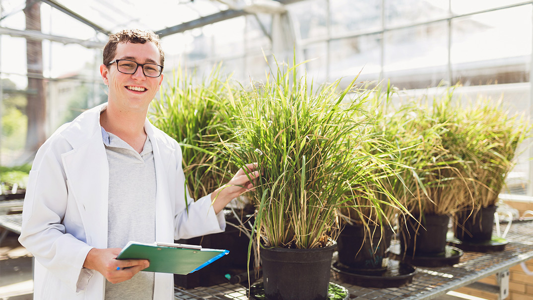 student with plants