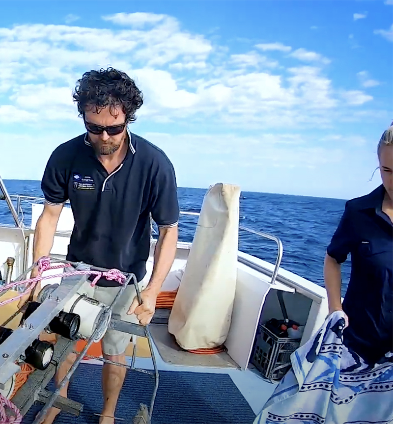 Marine researchers on a boat in the Ningaloo Reef